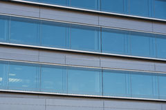 Office buildings with modern corporate architecture. Business and success concept, blue sky, windows Stock Photo