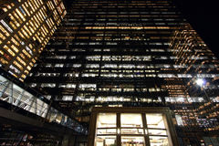 Office buildings night. Exterior of a tall, modern office building at night Royalty Free Stock Photography