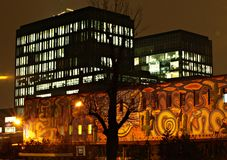 Office buildings. At night, illuminated interiors, glass façade, trendy finish, warsaw, poland stock images