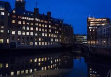 Office buildings at night reflected in river, Hamburg, Germany stock photography