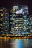 Office buildings at night in Singapore. Royalty Free Stock Image