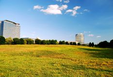 Office buildings and open field Royalty Free Stock Image