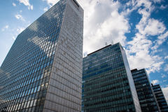 Office buildings. Photo of the office buildings with glass windows. Sky in the background Stock Photo