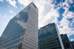 Office buildings. Photo of the office buildings with glass windows. Sky in the background Stock Image