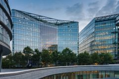 Office buildings on the south bank of the river Thames in London. At sunset time Royalty Free Stock Image