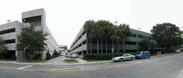 Office buildings and street. Panorama of office building complex and street stock image