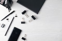 Office business black stationery including notebook, pen, phone royalty free stock images