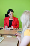 Office business interview lady woman two write work. Office business dialogue women two talking work interview write teamwork lady Royalty Free Stock Image