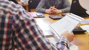 Office: Business people in meeting room discussing financial report using data and gadget. Defocused stock video footage