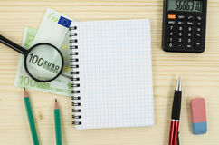 Office, business tools with notebook and euro Stock Image