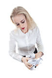 Office business woman crumpling displeased office paper. Young pretty office worker emotionally crumples hands overhead sheets Stock Photos