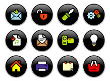 Office buttons. 12 office & computer theme icons on black shiny buttons Royalty Free Stock Photos