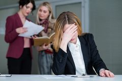 Office buzz woman headache noisy workspace. Office rush and buzz. women with a headache in busy and noisy workspace can`t concentrate on work Royalty Free Stock Photo
