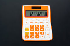 Office calculator. Of white-red color against a dark background Stock Image