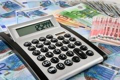 Office calculator on Euro banknotes stock photos