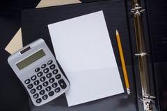 Office calculator on a folder Stock Photo