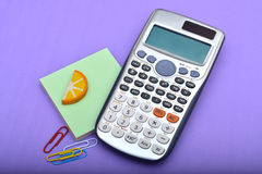 Office Calculator with Paper Pins Closeup Royalty Free Stock Image