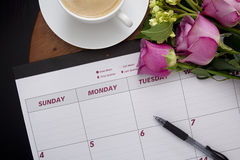 Office calendar planner on the coffee table. With a cup of coffee Royalty Free Stock Photo