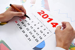 In the office with a 2014 calendar Stock Photos