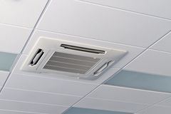 Office ceiling. With air-conditioner and lamps stock photography