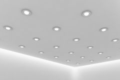 Office ceiling of empty white room with round ceiling lamps. Abstract architecture white room interior - office ceiling of empty white room with white wall Royalty Free Stock Images