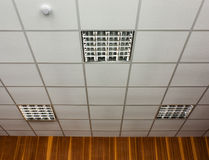 Office ceiling with lamps. White office ceiling with built-in fluorescent lamps stock images