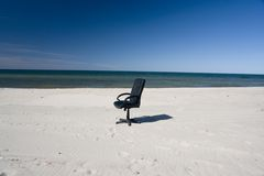 Office Chair on Beach Royalty Free Stock Images