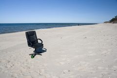 Office chair on the beach Royalty Free Stock Photography