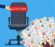 Office chair . Hiring and recruiting. Office chair and cardboard paper with we need you message in hand of boss. Human resources management concept, searching Royalty Free Stock Photo