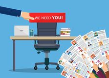 Office chair . Hiring and recruiting. Office chair and cardboard paper with we need you message in hand of boss. Human resources management concept, searching Stock Photos