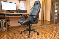 Office chair at the computer desk. Office chair at home computer desk Royalty Free Stock Photography