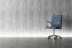 Office chair and concrete wall concept Stock Photos