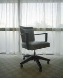 Office Chair In Front Of Window Stock Photo