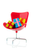 Office chair with gifts Royalty Free Stock Image