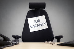 Office chair with job vacancy sign royalty free stock photography