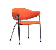 The office chair from orange leather. Isolated Stock Photography
