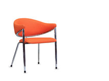 The office chair from orange leather. Isolated Royalty Free Stock Image