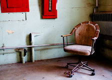 Office chair in prison room Royalty Free Stock Photo