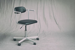 Office chair in a studio Royalty Free Stock Photography