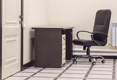 Office chair and table. Light office room with a black chair and a table Stock Images