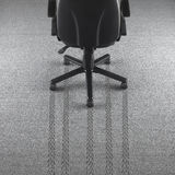 Office chair with tire marks in the carpet Stock Photos