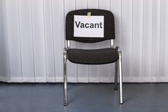 Office chair with a vacant sign Stock Image