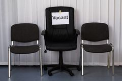 Office chair with a vacant sign Royalty Free Stock Photos