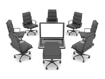 Office chairs around a laptop Royalty Free Stock Photos
