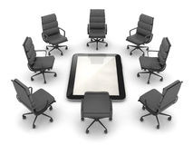 Office chairs around the tablet computer Royalty Free Stock Photography