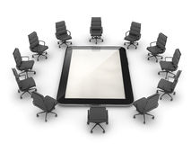 Office chairs around the tablet computer Stock Images