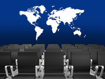 Office Chairs in a Conference Hall. Black office chairs in a conference hall with world map on blue background Royalty Free Stock Images