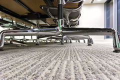 Office chairs view under desk table Stock Images