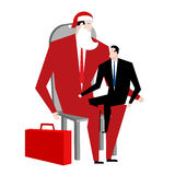 Office Christmas. Manager sitting on lap of boss. Santa Claus co Stock Photos