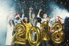 Office new year party. Young people having fun. Office christmas party. Group of joyful colleagues having fun at new year celebration. Happy smiling people stock images